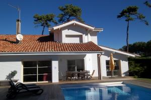 chalet-style summer villa with pool & easy access to beach & restaurants
